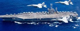 中国海军刚走 美航母战斗群突然开进南海